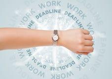 Ρολόγια με την εργασία και την προθεσμία γύρω από το γράψιμο Στοκ εικόνα με δικαίωμα ελεύθερης χρήσης
