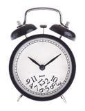 Ρολόι συναγερμών με μια δέσμη των αριθμών στον πίνακα Στοκ Εικόνες