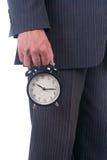 Ρολόι συναγερμών σε ένα χέρι Στοκ Φωτογραφία