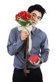 Ρομαντικό άτομο με ένα κιβώτιο και τα λουλούδια δώρων Στοκ Εικόνα