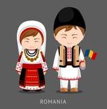 Ρουμάνοι στο εθνικό φόρεμα με μια σημαία απεικόνιση αποθεμάτων