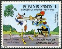 ΡΟΥΜΑΝΙΑ - 1986: παρουσιάζει το Donald και τρομπονίστα, χαρακτήρες Walt Disney στη συναυλία ζωνών, το 1935, πενήντα έτη ζωντανεψον ελεύθερη απεικόνιση δικαιώματος