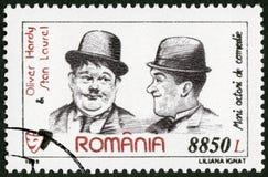 ΡΟΥΜΑΝΙΑ - 1999: παρουσιάζει Oliver σκληραγωγημένη δάφνη του 1892-1957 και Stan (1890-1965), κωμικοί δράστες σειράς Στοκ Φωτογραφίες
