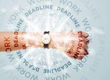 Ρολόγια με την εργασία και την προθεσμία γύρω από το γράψιμο Στοκ Φωτογραφία