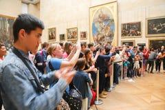 Ρολόγια Monalisa λαών - Leonardo Da Vinci Στοκ Φωτογραφίες