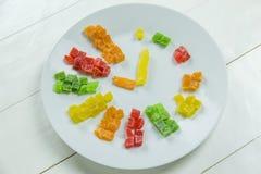 Ρολόι φρούτων με τα γλασαρισμένα φρούτα Στοκ εικόνα με δικαίωμα ελεύθερης χρήσης
