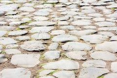 Ρωμαϊκή οδός κυβόλινθων αυτοκρατοριών σε Ostia Antica - τη Ρώμη - την Ιταλία Στοκ εικόνες με δικαίωμα ελεύθερης χρήσης