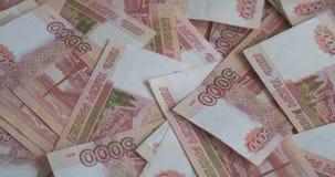Ρωσικά τραπεζογραμμάτια ρουβλιών χρημάτων, σωρός των ρωσικών ρουβλιών φιλμ μικρού μήκους