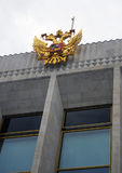 Ρωσικός χρυσός αετός καλύψεων των όπλων Στοκ Φωτογραφίες
