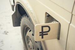 Ρωσικό ρούβλι στο εκλεκτής ποιότητας αυτοκίνητο Στοκ Εικόνες