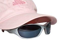 ρόδινα γυαλιά ηλίου ΚΑΠ Στοκ φωτογραφία με δικαίωμα ελεύθερης χρήσης