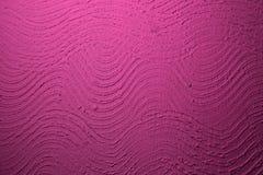 Ρόδινος κυματισμένος grunge στόκος στη σύσταση τοίχων - φανταστικό αφηρημένο υπόβαθρο φωτογραφιών στοκ φωτογραφία