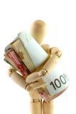 ρόλος χρημάτων εκμετάλλευσης κουκλών ξύλινος Στοκ εικόνα με δικαίωμα ελεύθερης χρήσης