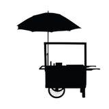 Ρόδα καροτσακιών χοτ-ντογκ με τη σκιαγραφία ομπρελών Στοκ εικόνες με δικαίωμα ελεύθερης χρήσης