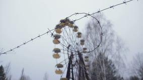 Ρόδα Ferris στο εγκαταλειμμένο λούνα παρκ Pripyat φιλμ μικρού μήκους