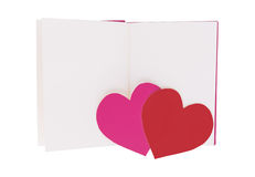 Ρόδινη και κόκκινη καρδιά εγγράφου στο κενό ανοικτό βιβλίο που απομονώνεται στο λευκό στοκ φωτογραφία