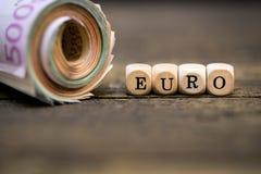 Ρόλος χρημάτων με το ευρώ λέξης Στοκ φωτογραφίες με δικαίωμα ελεύθερης χρήσης