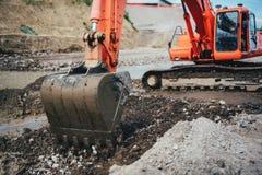 Σέσουλα εκσκαφέων στο ρύπο, που λειτουργεί στην οικοδόμηση εθνικών οδών και το ίδρυμα οικοδόμησης Στοκ Εικόνες