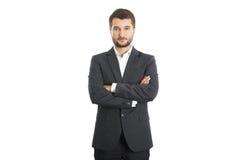 Σίγουρος επιχειρηματίας με τα διπλωμένα χέρια στοκ φωτογραφίες