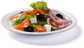 Σαλάτα που εξυπηρετείται στο άσπρο πιάτο Στοκ εικόνα με δικαίωμα ελεύθερης χρήσης