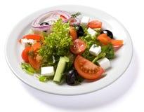 Σαλάτα που εξυπηρετείται στο άσπρο πιάτο Στοκ Εικόνες