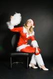 σαν όμορφο ξανθό ντυμένο santa κ&om Στοκ Εικόνες