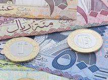 Σαουδικά 10 τραπεζογραμμάτια Riyal 500, 100 & και νέο νόμισμα Στοκ Φωτογραφίες
