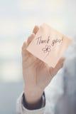 Σας ευχαριστούμε κείμενο στη συγκολλητική σημείωση Στοκ Φωτογραφίες