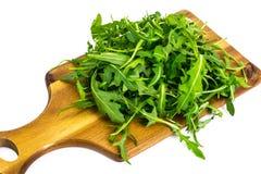 Σαλάτα arugula-συστατικών στους ξύλινους πίνακες Στοκ φωτογραφία με δικαίωμα ελεύθερης χρήσης