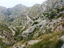 Σειρά βουνών Majorca που χαρακτηρίζει το δύσκολο τοπίο & που στρίβει το φιδωτό δρόμο Στοκ Φωτογραφίες