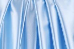 Σειρά στο μπλε σατέν Στοκ Εικόνες