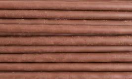 Σειρές της σοκολάτας στα ραβδιά μπισκότων Στοκ εικόνα με δικαίωμα ελεύθερης χρήσης