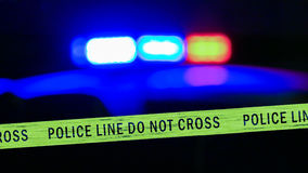 Σειρήνα περιπολικών της Αστυνομίας Defocused με την ταινία ορίου Στοκ Εικόνες