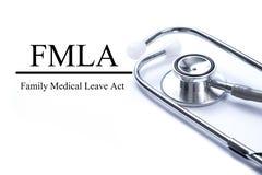 Σελίδα με πράξη οικογενειακής την ιατρική άδειας FMLA στον πίνακα με το stetho στοκ εικόνα
