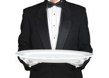 Σερβιτόρος με το μεγάλο άσπρο δίσκο Στοκ εικόνα με δικαίωμα ελεύθερης χρήσης