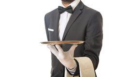 Σερβιτόρος που κρατά έναν δίσκο Στοκ Φωτογραφία