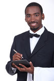 Σερβιτόρος που παίρνει μια διαταγή Στοκ Εικόνα