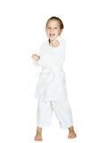 Σε ένα άσπρο υπόβαθρο το μικρό κορίτσι κτύπησε έναν βραχίονα διατρήσεων Στοκ Εικόνες