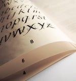 Σελίδα βιβλίων με το αλφάβητο Στοκ Εικόνες