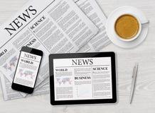 Σελίδα ειδήσεων στην ταμπλέτα, το κινητές τηλέφωνο και την εφημερίδα Στοκ εικόνα με δικαίωμα ελεύθερης χρήσης