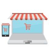 Σε απευθείας σύνδεση κατάστημα Πώληση, lap-top και έξυπνο τηλέφωνο με awning Στοκ Εικόνες