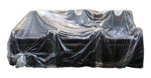 Σελοφάν καναπέδων που καλύπτεται που καλλιεργείται στο λευκό Στοκ εικόνες με δικαίωμα ελεύθερης χρήσης
