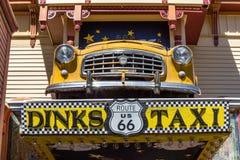 Σημάδι ταξί Dinks Στοκ Φωτογραφίες