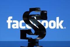 Σημάδι αμερικανικών δολαρίων και λογότυπο Facebook Στοκ Εικόνα