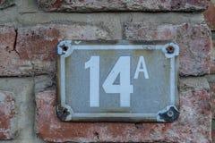 Σημάδι για τον αριθμό σπιτιών 14A Στοκ Φωτογραφία