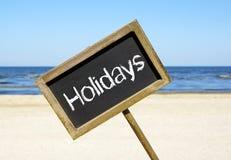Σημάδι διακοπών σε μια παραλία Στοκ Εικόνα