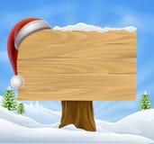 Σημάδι καπέλων Santa Χριστουγέννων τοπίων χιονιού Στοκ Εικόνα