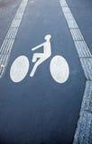 Σημάδι παρόδων ποδηλάτων στην άσφαλτο Στοκ εικόνες με δικαίωμα ελεύθερης χρήσης