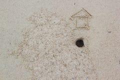 Σημάδι σπιτιών στην άμμο Στοκ Φωτογραφίες