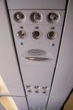 Σημάδι, σύμβολο και κάποιος εξοπλισμός μέσα στο αεροπλάνο Στοκ Φωτογραφία